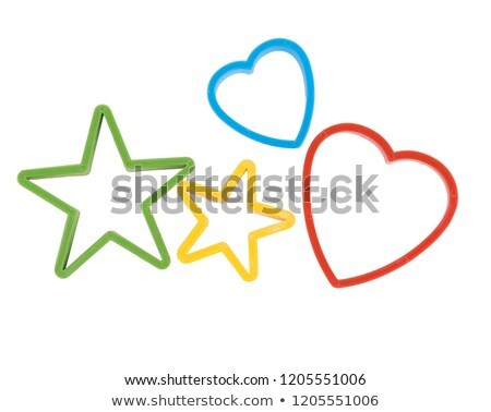 Heart shaped cookies cutters on a red background Stock photo © danielgilbey