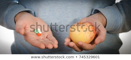 hand selecting image of doctor holding apple stock photo © wavebreak_media
