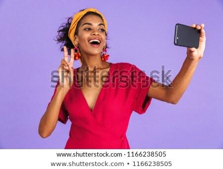 Animado bastante africano mulher isolado violeta Foto stock © deandrobot