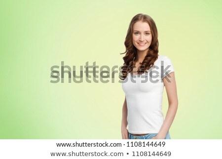 Gelukkig slank vrouw witte tshirt kalk Stockfoto © dolgachov