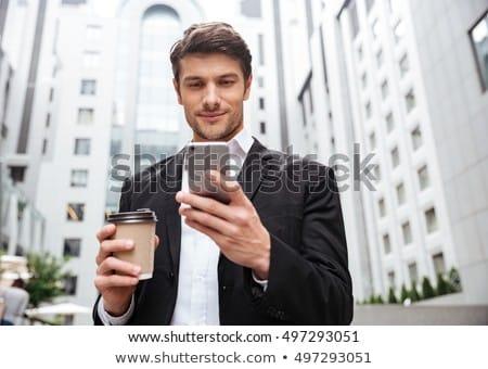 Affaires smartphone bureau escaliers gens d'affaires technologie Photo stock © dolgachov
