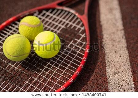 Három citromsárga tenisz gömbök ütő fehér Stock fotó © pressmaster