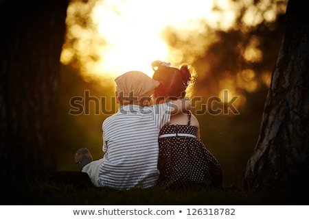 Scene with boy and girl in the garden Stock photo © bluering