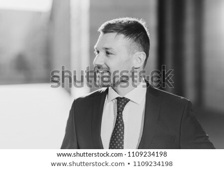 Sideways shot of cheerful unshaven male looks aside with joyful expression, wears formal clothes, be Stock photo © vkstudio