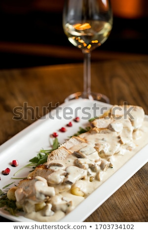 Chicken meat on grated gnocchi in cream sauce of mushrooms and s Stock photo © boggy