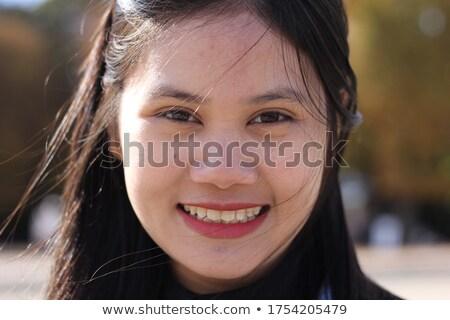 Kép örömteli gyönyörű ázsiai lány mosolyog Stock fotó © deandrobot