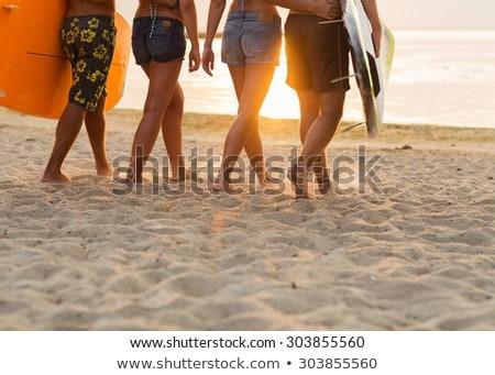 Fiatal srác szórakozás vízpart naplemente tengerpart gyermek Stock fotó © Lopolo