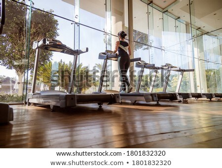 Woman running on treadmill in gym. Ealthy lifestyle. Stock photo © cookelma