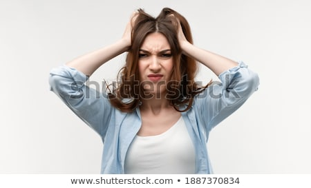 Image of excited woman expressing surprise and grabbing her head Stock photo © deandrobot