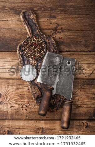 Vintage hatchet for meat on wooden chopping board with salt and pepper on wooden table background. S Stock photo © DenisMArt