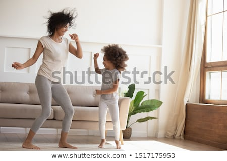 mother spending time with little daughters at home Stock photo © dolgachov