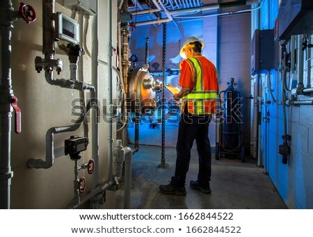 Stock photo: Engineer with a clipboard