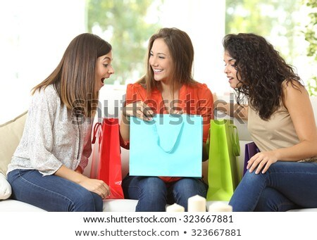 three female friends at home with shopping bags Stock photo © photography33