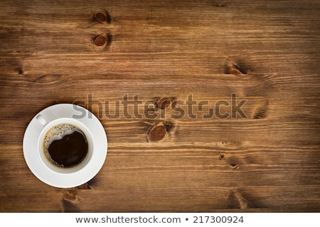 Drinking out of hot espresso cup on wooden table Stock photo © nalinratphi