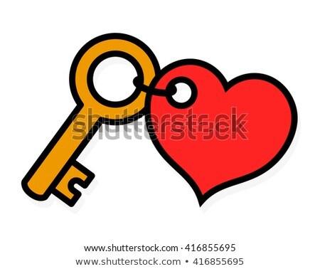 Pequeño latón clave rojo etiqueta romántica Foto stock © adrian_n