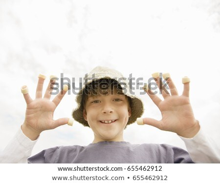 Boy with hoop crisps on fingers Stock photo © IS2