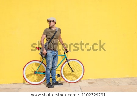 Casual Man Walking On The Street Fixing His Sunglasses Stockfoto © 2Design