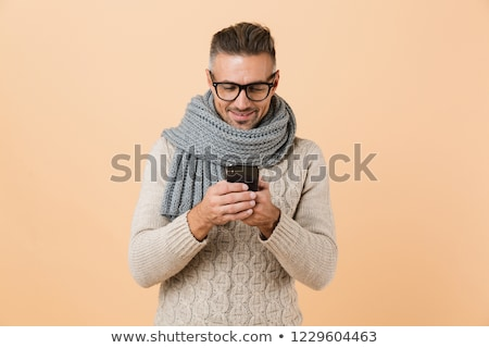 Portrait heureux jeune homme chandail écharpe isolé Photo stock © deandrobot