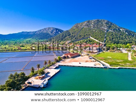 Town of Ston bay and salt fields aerial panoramic view Stock photo © xbrchx
