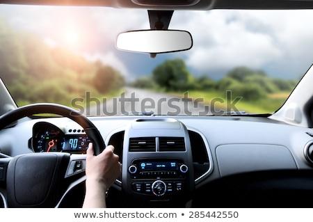 Driver's hands on steering wheel inside of a car Stock photo © galitskaya