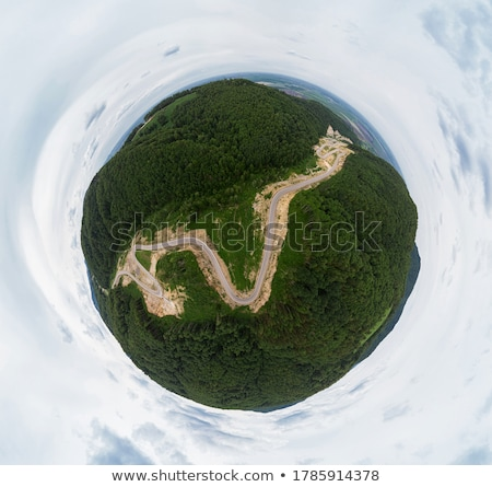 Aerial top vew of winding road in the mountains Stock photo © olira