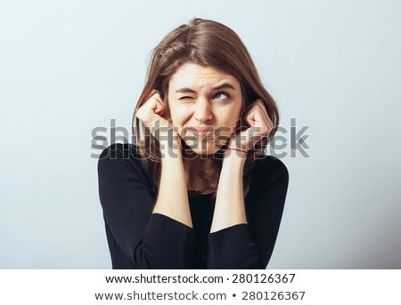 Woman covering ears Stock photo © photography33