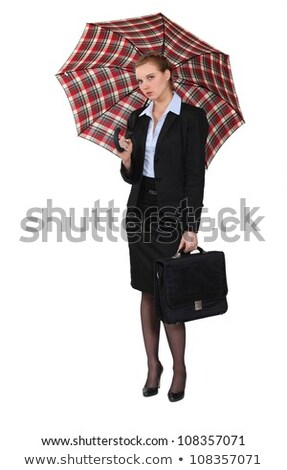 Austere businesswoman holding a briefcase and an umbrella Stock photo © photography33