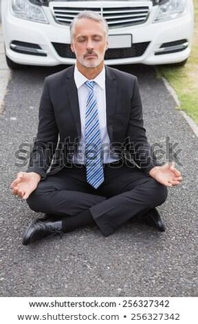 Businessman meditating after his car broken down  Stock photo © wavebreak_media