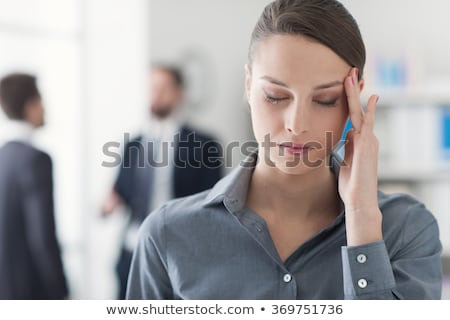 beautiful young woman with headache touching her temples stock photo © master1305