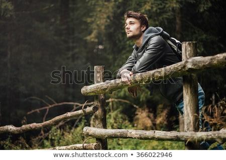 Uomo zaino legno recinzione foresta Foto d'archivio © wavebreak_media