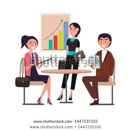 woman with folder making report at chartboard stock photo © robuart