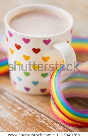cup with heart pattern and gay awareness ribbon Stock photo © dolgachov
