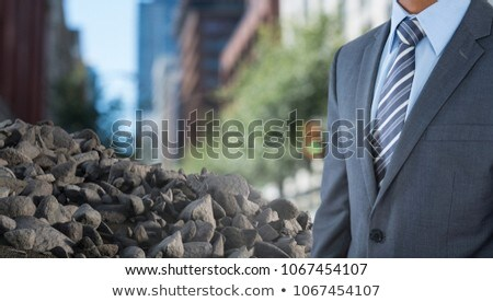 ruibble stones in pile with businessman in city stock photo © wavebreak_media