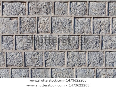 Graven stone blocks or bricks surface with cement grout Stock photo © lightkeeper
