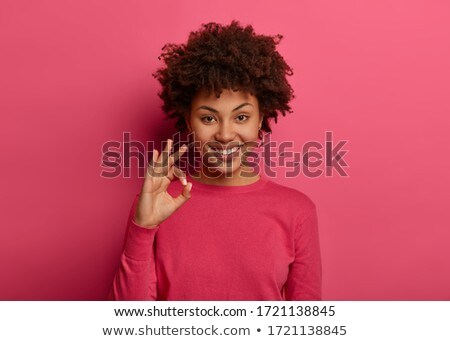 I like it! Portrait of happy woman with Afro hairstyle, shows thumb up, gives positive opinion, look Stock photo © vkstudio