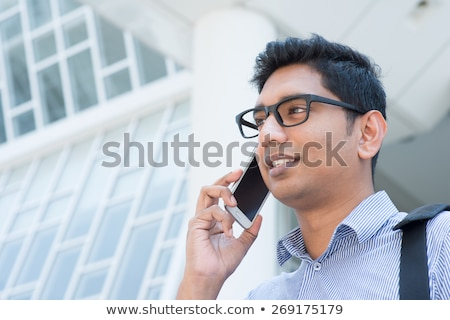 Young Man With Cellphone In Front Of A Modern Building Foto d'archivio © szefei
