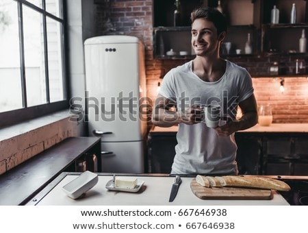 Man drinking coffee in kitchen Stock photo © photography33