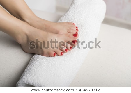 female feet with a white rolled towel Stock photo © Nobilior