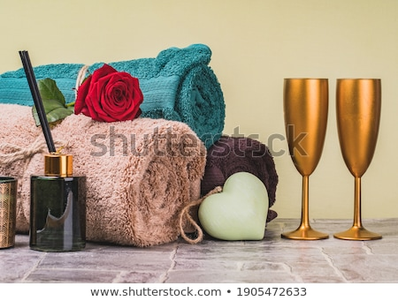 red and cream colored roses with two champagne glasses and a champagne bottle stock photo © rob_stark