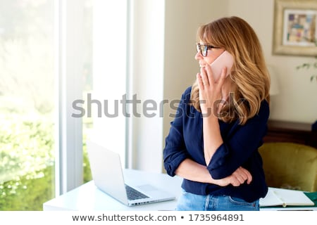 portrait of beautiful businesswoman talking on the phone and cel Stock photo © feedough