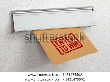 A letter stamped Enter to win in a mail slot Stock photo © Zerbor