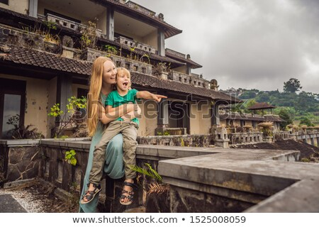 mother and son tourists in abandoned and mysterious hotel in Bedugul. Indonesia, Bali Island. Bali T Stock photo © galitskaya