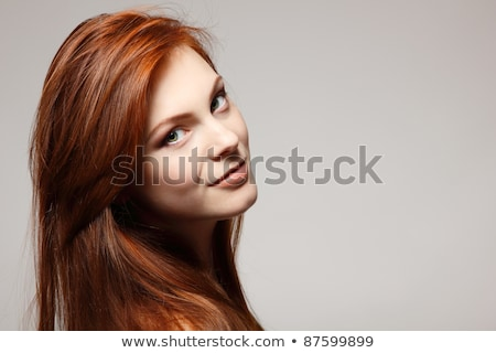 smiling brunet woman in red Stock photo © marylooo