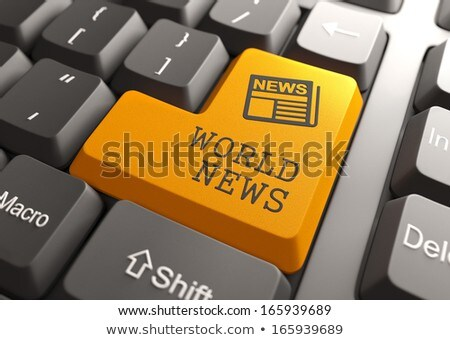 World News Concept on Orange Keyboard Button. Stock photo © tashatuvango