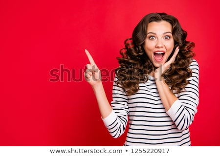woman in striped pullover pointing her finger up Stock photo © dolgachov