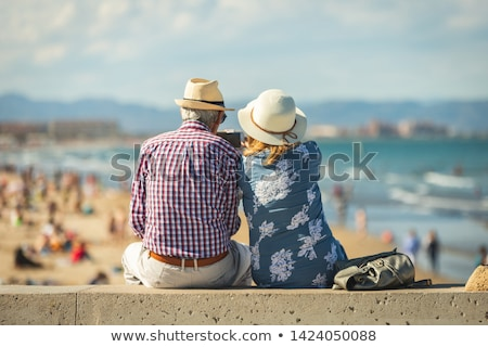 couple with bikes sitting on the sand dunes stock photo © photography33