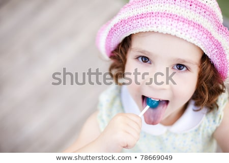 Beautiful young woman licking lollypop Stock photo © Nejron