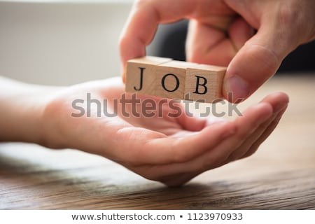 Person Giving Wooden Block With Job Text To Candidate Stock photo © AndreyPopov