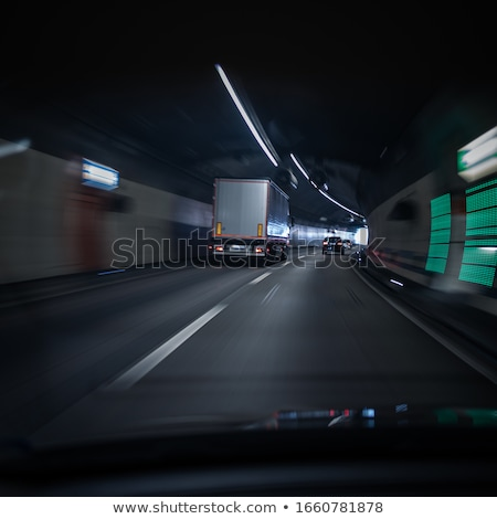 Photo stock: Cars On A Highway Going Through A Long Modern Tunnel