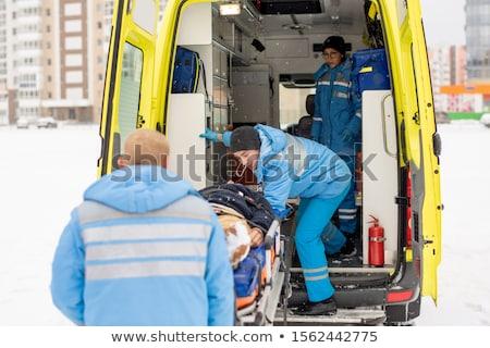 Vast bewusteloos man ambulance auto Stockfoto © pressmaster